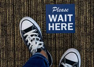 Feet standing at floor sign