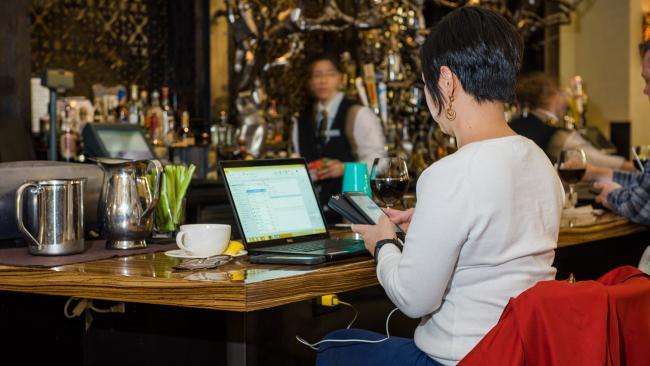 Woman using wi-fi internet in the Terminal