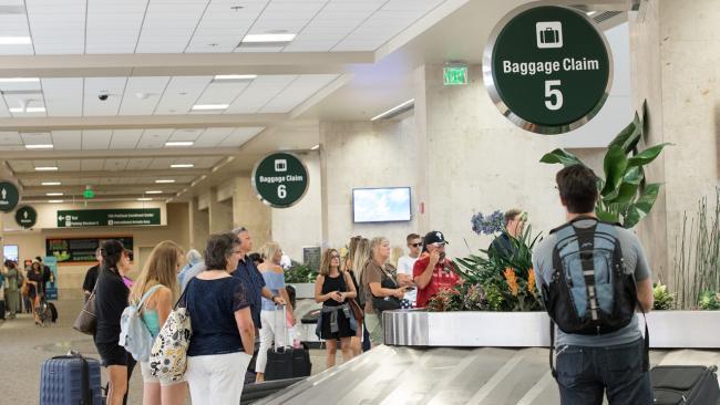 People waiting at baggage claim