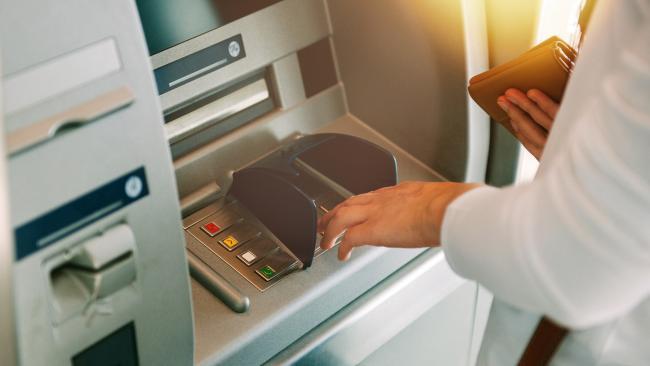 Woman at ATM