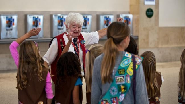 Tour guide with Girl Scouts in the Airport