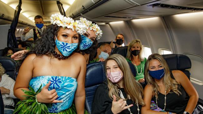 United flight to Honolulu passengers on plane